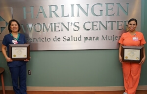 Harlingen Women's center doctors holding awards